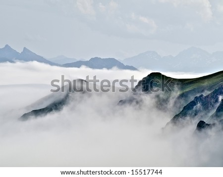 French Pyrenees mountains range in fog HDR processed - stock photo