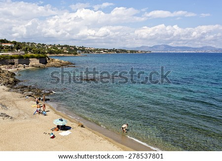 FRENCH RIVIERA, FRANCE - SEPTEMBER 12, 2014: Enjoying the warm water of the Mediterranean Sea in the French Riviera - stock photo