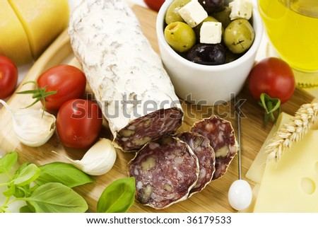 French Salami, garlic, tomato, olives and cheese