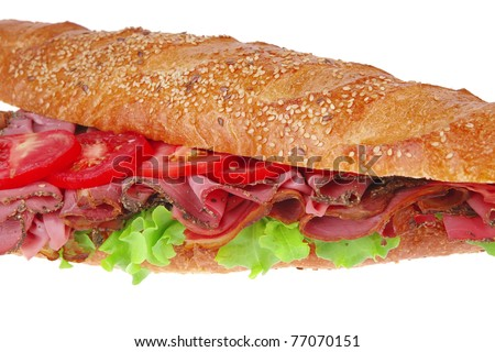 french sandwich : fresh white baguette with chicken smoked sausage isolated over white background