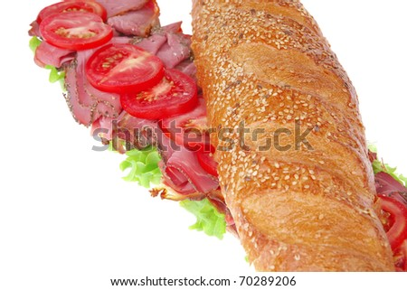 french sandwich: long baguette with smoked chicken sausage isolated on white background