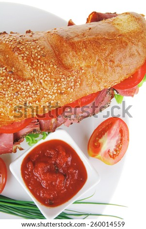 french sandwich on white plate: long baguette with smoked chicken sausage and chives isolated on white background - stock photo