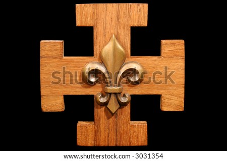 French Scout Emblem - Antique scouting fleur-de-lis on solid oak wood.  Isolated on black background. - stock photo