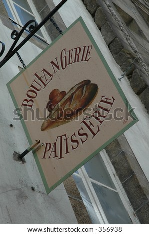 French shop sign in St. Malo. - stock photo