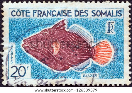 "FRENCH SOMALI COAST - CIRCA 1958: A stamp printed in the French Somali Coast from the ""Animals, Fishes and Birds"" issue shows a Balistes capriscus fish, circa 1958."