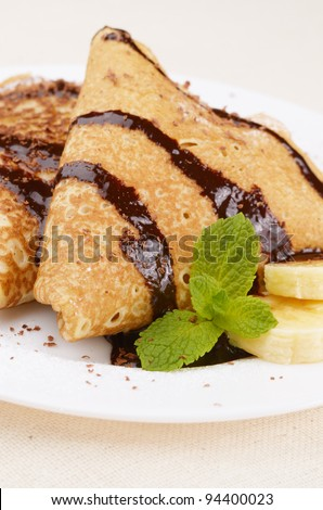 French style crepes with banana, chocolate syrup and chips