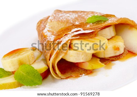 French style crepes with banana, maple syrup and sugar powder isolated on white - stock photo