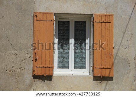 French style window with wooden shutters