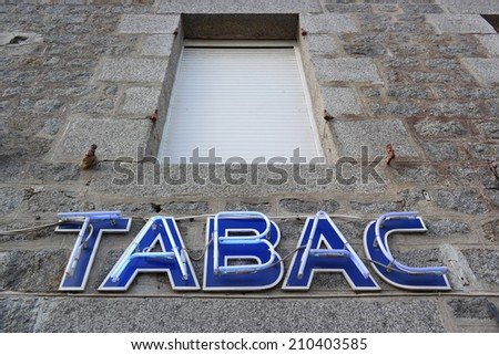 French Tabac Neon sign at facade of a tobacconist  - stock photo