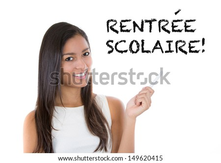 French teacher or student woman. Back to School written in French on white background by female on chalkboard.  Professor teaching French language at university, high school or primary school. - stock photo