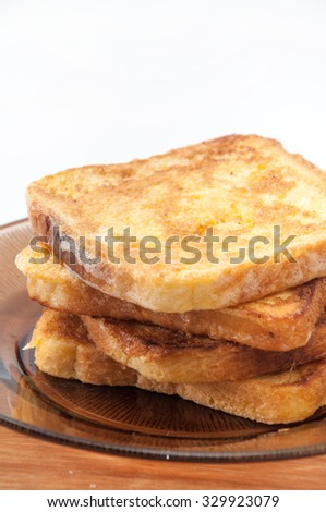 French toast arranged on a brown plate.