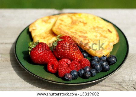 French toast breakfast with fresh berries outdoors - stock photo