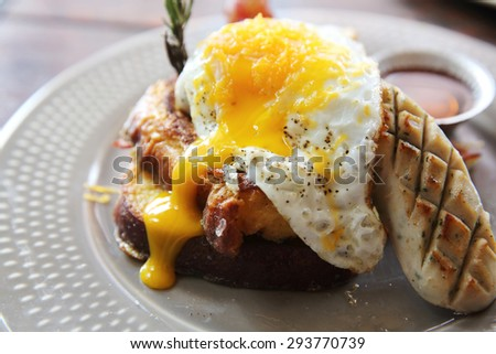French Toast Eggs and Bacon Breakfast Brekkie Stack - stock photo