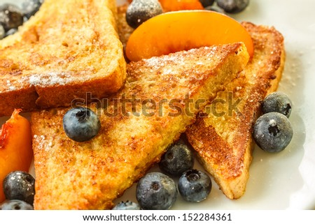 French toast with blueberries and nectarine - stock photo