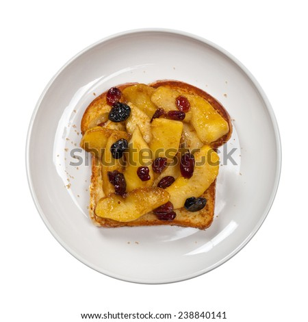 French toast with caramelized apples and dried cranberries. Isolated on white. Selective focus. - stock photo