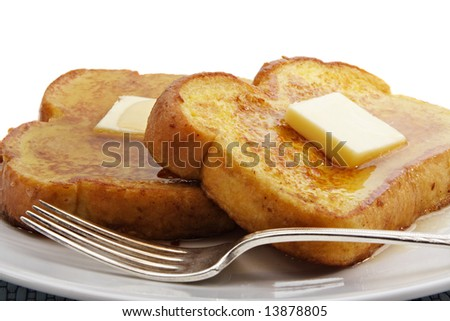 french toast with piece of butter, isolated on white - stock photo