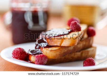 French toast with raspberry jam on a plate - stock photo
