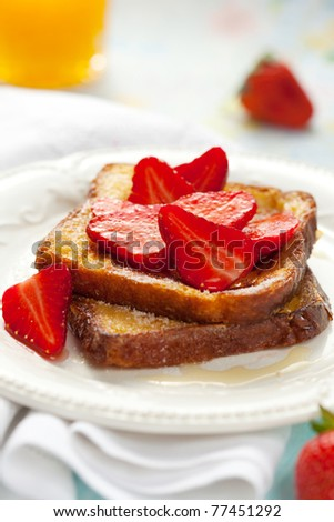 French toast with strawberries, maple syrup and  sugar