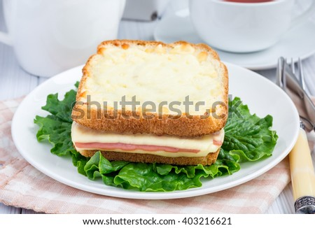 French toasted sandwich Croque monsieur with ham and cheese - stock photo
