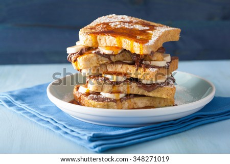 french toasts with banana chocolate sauce and caramel for breakfast - stock photo