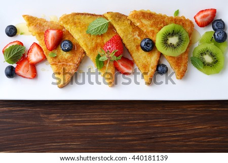 french toasts with fresh berries, food top view - stock photo