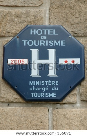 French tourism hotel grading sign - stock photo