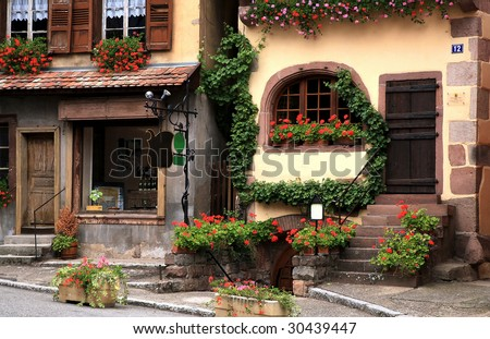 French traditional house with half-timbered wall. La route du vin, route of vines, Dambach village in Alsace - France. - stock photo