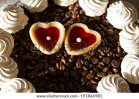 French vanilla meringue cookies and two sweet hearts - stock photo