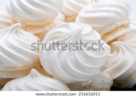 French vanilla meringue cookies on white background  - stock photo