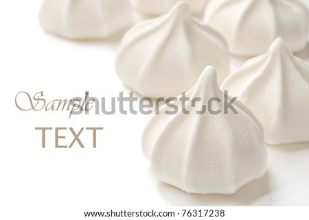 French vanilla meringue cookies on white background with copy space.  Macro with shallow dof.