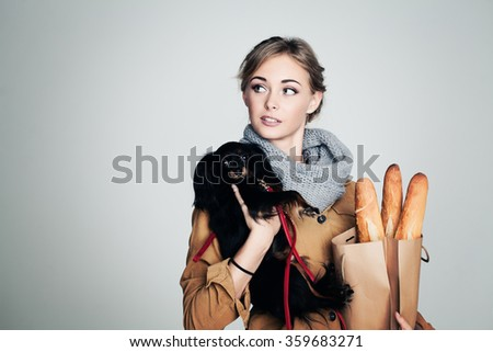 French Woman with Small Dog and Baguette on Background with Copy Space - stock photo
