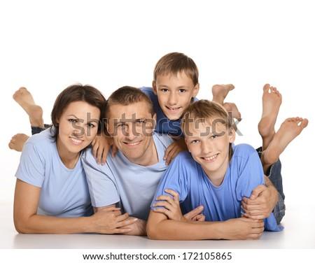 Frendly family on the floor on white background - stock photo