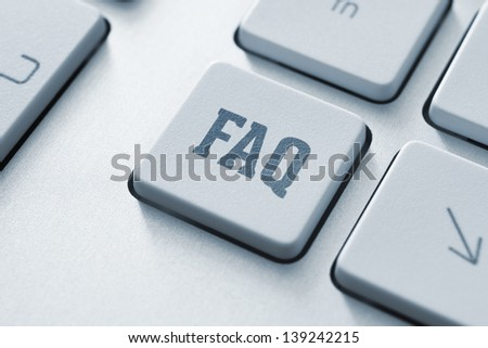 Frequently asked question button on a modern computer keyboard - stock photo