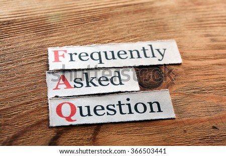 frequently asked question (FAQ) concept for website service on wood - stock photo