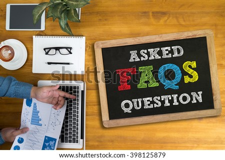 Frequently Asked Questions Faq Feedback  Concept Businessman working at office desk and using computer and objects, coffee, - stock photo