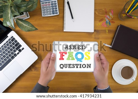 Frequently Asked Questions Faq Feedback  Concept Corporate identity mock up on an hardwood desk with laptop, tablet, smartphone and a cup of coffee, top view - stock photo