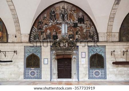 Fresco above main entrance into Saint James Cathedral in the Armenian Quarter. Jerusalem, Israel. - stock photo