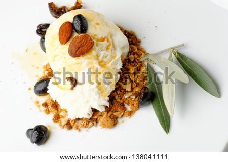 Fresh almond ice cream on plate close up - stock photo