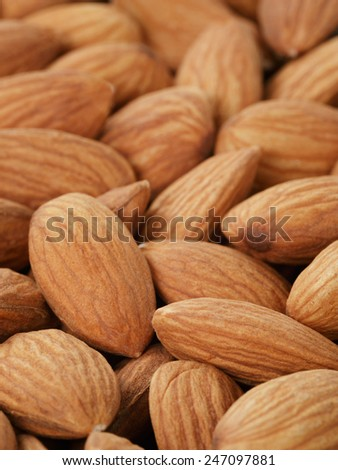 fresh almond peeled nuts background, close up photo