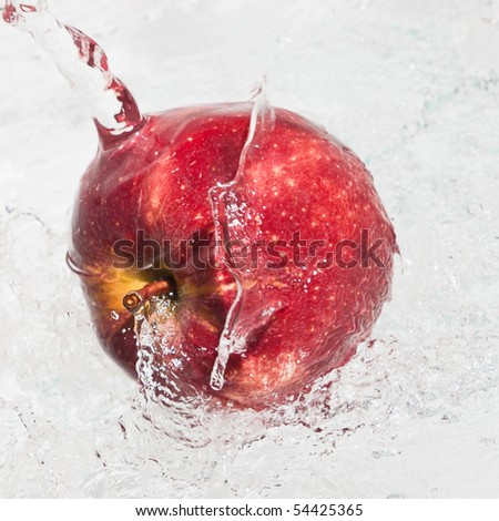 Fresh an apple in streaming water. - stock photo