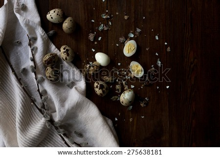fresh and boiled quail eggs from a farmers market soft focus overhead-angle shot in rustic style on dark wood background soft focus overhead-angle shot - stock photo