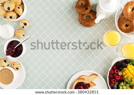Fresh and bright continental breakfast table with fruit plate from above - stock photo
