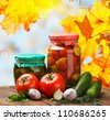 fresh and canned vegetables with herbs - stock photo