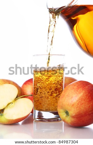 Fresh and cold apple juice against white background - stock photo