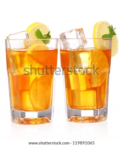 Fresh and cold ice tea with sliced lemon and mint