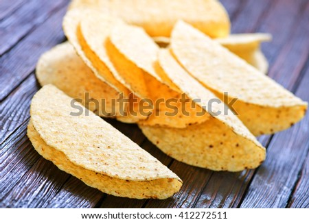 fresh and crunchy delicious mexican taco shells - stock photo