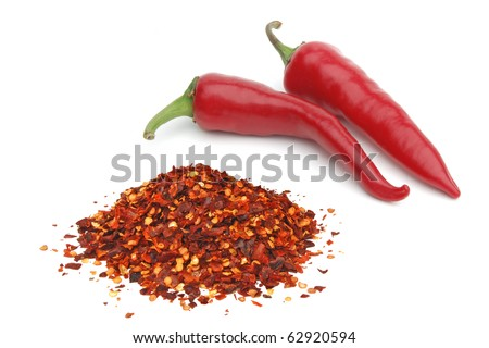 Fresh and crushed pimienta roja red pepper on white background - stock photo