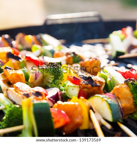 Fresh and delicious barbecue with skewers with vegetables. - stock photo