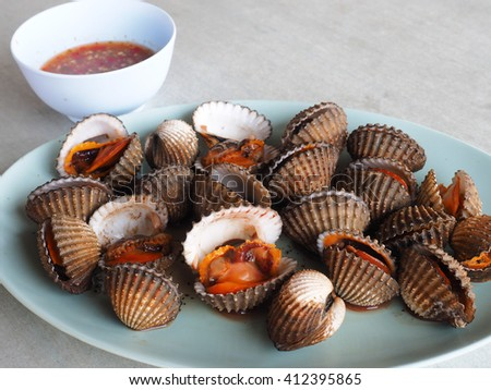 Fresh and Delicious boiled blood cockles with spicy sauce  - stock photo