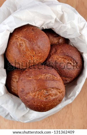 Fresh and delicious bread in a paper bag - stock photo